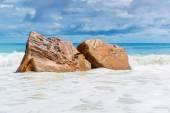 Rocks on tropical beach — Stock Photo
