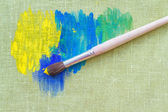 Oil paints and paint brush — Stock Photo