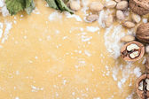 Background dough with nuts and flour — Stock Photo