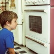 Looking at oven — Stock Photo #53747043
