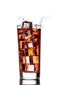 Ice splashing in cup of tea — Stock Photo