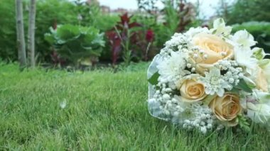 Wedding Bouquet On The Grass — Stock Video