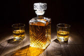 Whiskey decanter with two glasses — Stock Photo