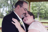Bride Lays Head on Grooms Shoulder — Stock Photo