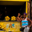 Two Cuban women at a small floral shop in Old Havana — Stock Photo #65023221