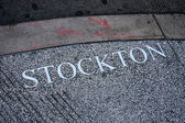 SAN FRANCISCO, CA, SEPT 20, 2010 - Stockton Street title engraved in pavement on Sept 29, 2010 in San Francisco. Stockton is home to numerous stores near the Union Square and Chinatown — Foto Stock
