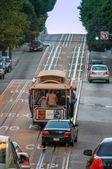 SAN FRANCISCO, CA, SEPT 24, 2008 - Cable car scramble up steep rise at Powell street on Sept 24, 2008 in San Francisco.  This mechanical public transport is in service since 1871 — Stock Photo