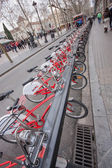 BARCELONA, SPAIN - FEB 9, 2014: Row of bicycles Bicing sharing system on Feb 9, 2014 in Barcelona, Spain. City's renting service inaugurated in 2007 now has over 100,000 registered users — Stock Photo