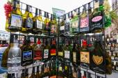 SAN FRANCISCO, CA, US - OCT 2, 2011: Rack with empty flat souvenir popular alcohol drinks bottles for tourist shopping in San Francisco on October 2, 2011 — Stock Photo