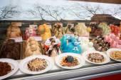 BARCELONA, SPAIN - FEB 9, 2014: Showcase of ice cream in window display at Rambla street in Barcelona Spain on Feb 9, 2014 — Stock Photo
