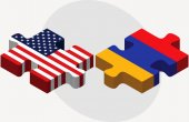 USA and Armenia Flags in puzzle — Stock Vector