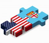 USA and Fiji Flags in puzzle — Stockvector