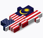 USA and Malaysia Flags in puzzle — Stock Vector