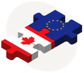 Canada and European Union Flags in puzzle — Stock Vector