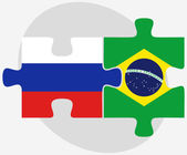 Russian Federation and Brazil Flags in puzzle — Stok Vektör