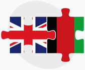 United Kingdom and Afghanistan Flags in puzzle — Stock Vector