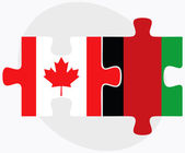 Canadá y banderas de Afganistán en puzzle — Vector de stock