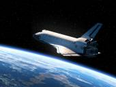 Space Shuttle Orbiting Earth — Stock Photo