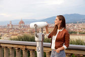 Beautiful girl impressed view the panorama of Florence at sunset — Stock Photo