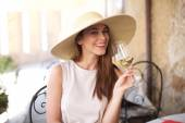 Young happy woman with glass of white wine — Stock Photo