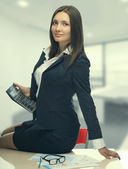 Secretary with calculator in office — Stock Photo