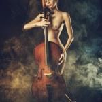 Naked girl playing cello — Stock Photo #58099231