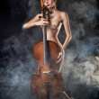 Naked girl playing cello — Stock Photo #58099267