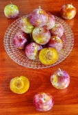 Fresh plums on table — Stock Photo