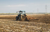 Tractor preparing land for sowing — Stock Photo
