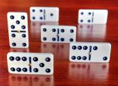 Dominoes on a wooden board — Stock Photo