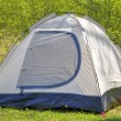 Camping tent in sunny forest — Stock Photo #72842553