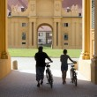Two cyclists in the castle Lednice — Stock Photo #52516125