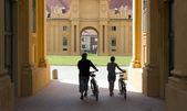 Two cyclists in the castle Lednice — Stock Photo