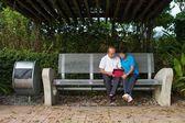 Senior couple looking at iPAD — Stock Photo
