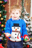 Portrait of little boy playing over christmas background — Stock Photo