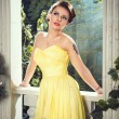Portrait of beautiful elegant young woman in gorgeous yellow evening dress — Stock Photo #74207851