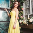 Portrait of beautiful elegant young woman in gorgeous yellow evening dress — Stock Photo #74208231