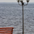 Lantern and bench on the lakeside promenade — Stock Photo #55424925