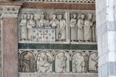 Bas relief on the Cathedral of St Martin wall, Lucca, Italy — Stock Photo