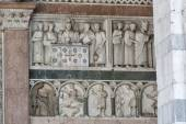 Bas relief on the Cathedral of St Martin wall, Lucca, Italy — Stockfoto