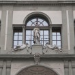 Ancient statues on Uffizi museum wall in Florence — Stock Photo #65822027
