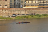 Team of rowers train in a boat in Florence, Italy. — Stock Photo
