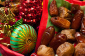 Dried figs and dates with Christmas decorations — Stock Photo