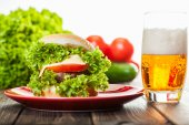 Cheeseburger on a plate with beer — Stok fotoğraf