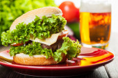 Cheeseburger on a plate with beer — Stock Photo