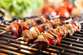 Grilling shashlik on barbecue grill — Stock Photo