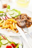 Pork chop with sauce, mushrooms and chips — Stock Photo
