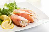 Smoked salmon roll with vegetable salad — Stock Photo
