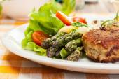 Meatballs served with boiled potatoes and asparagus — ストック写真