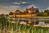 HDR image of medieval castle in Malbork at night with reflection — Stock Photo